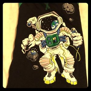 Astronaut in space shirt with green sleeves